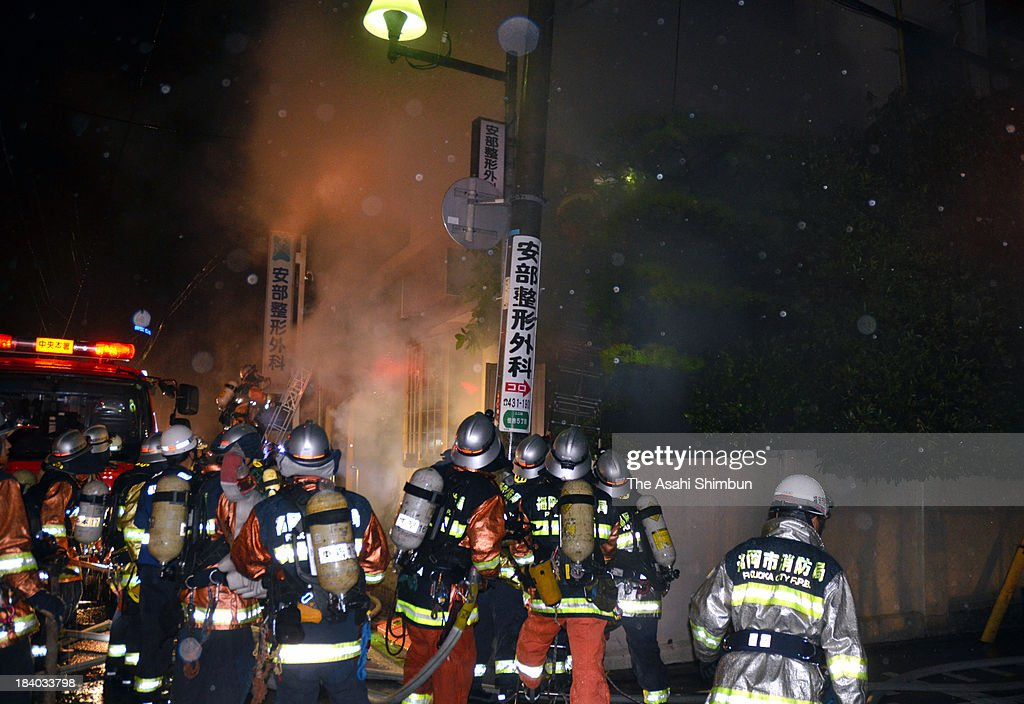 rescue work continues at a hospital fire site on October 11, 2013 in Fukuoka, Japan. 2 staffs and 8 patients were confirmed dead.