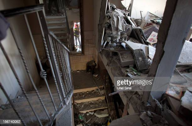 A rescue worker inspects a house after it was hit by a rocket fired from the Gaza Strip on November 20 2012 in Beersheba Israel Hamas militants and...