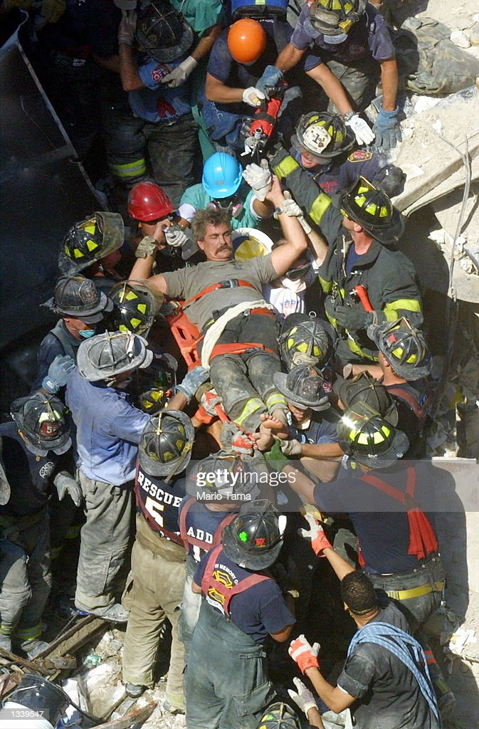 A rescue worker is pulled from the rubble of the World Trade Center September 13, 2001 in New York City two days after two hijacked airplanes slammed into the twin towers, levelling them and killing nearly 3,000 people.