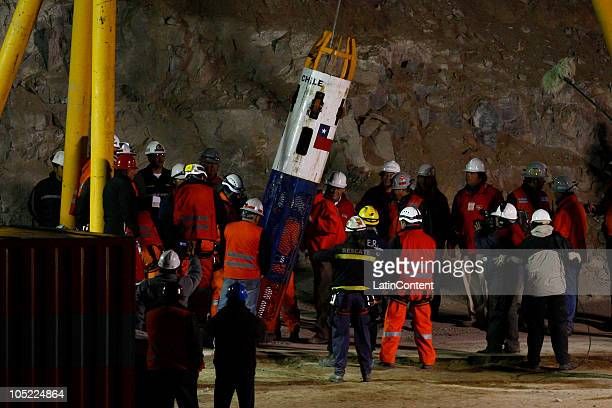 Rescue worker Manuel Gonzalez enters the Fenix capsule for the rescue operation of 33 Chilean miners trapped 700 meters underground for two months in...