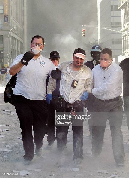A rescue worker receives assistance during the terrorist attack on The World Trade Center on Sept 11 2001