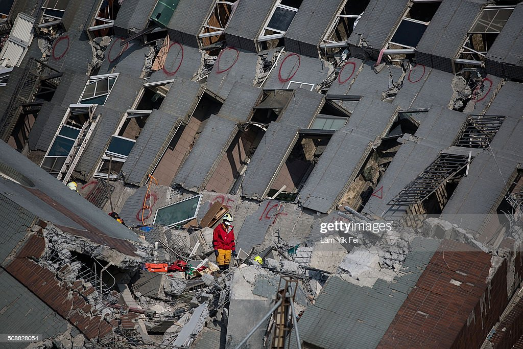 Rescue worker search for victim at a collapsed building on February 7, 2016 in Tainan, Taiwan. A magnitude 6.4 earthquake hit southern Taiwan early Saturday, toppling several buildings, killing at least fourteen people, and leaving over one hundred missing in Tainan.