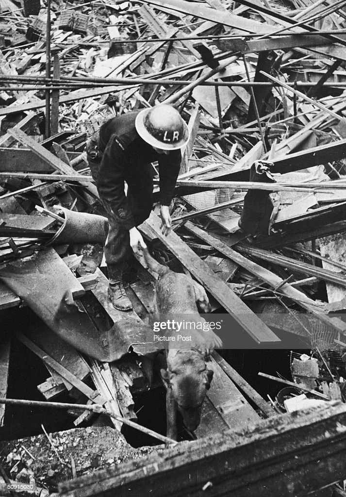 A rescue worker uses a sniffer dog to search for casualties in the ruins of Farringdon Market, London, after a V-2 rocket attack, which killed over 300 people, 8th March 1945. Original Publication : Picture Post - 1967 - One Story We Couldn't Tell - pub. 2 October 1948
