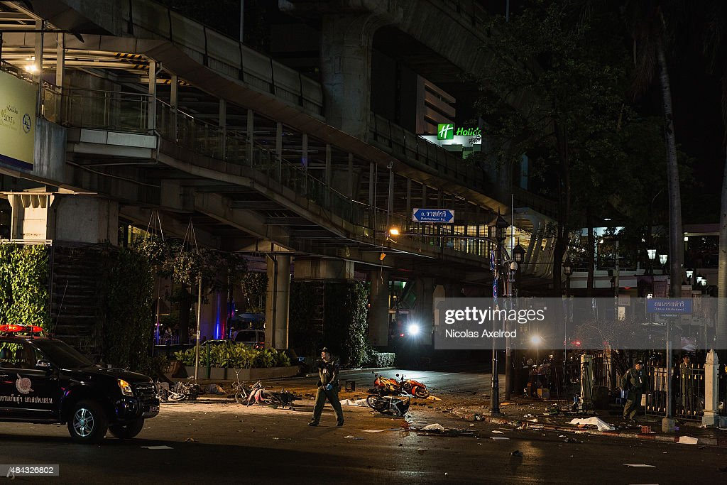 A rescue worker walks past the scene of an explosion on August 17 2015 in Bangkok Thailand A large explosion believed to be from a bomb has happened...