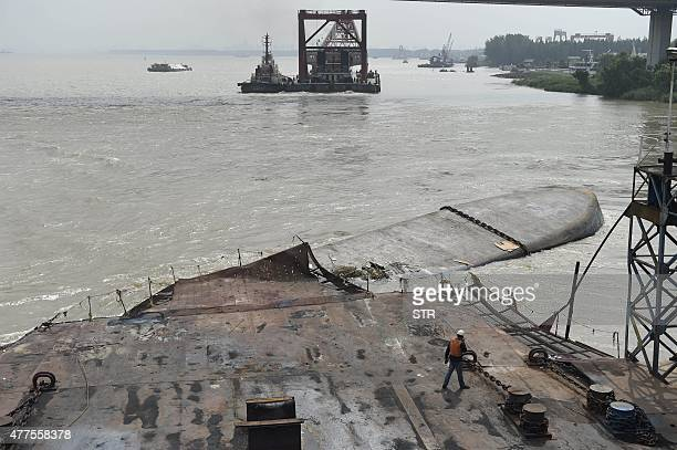 A rescue worker walks towards a Chinese cargo ship after it capsized on the Yangtze river near the eastern city of Nanjing in east China's Jiangsu...