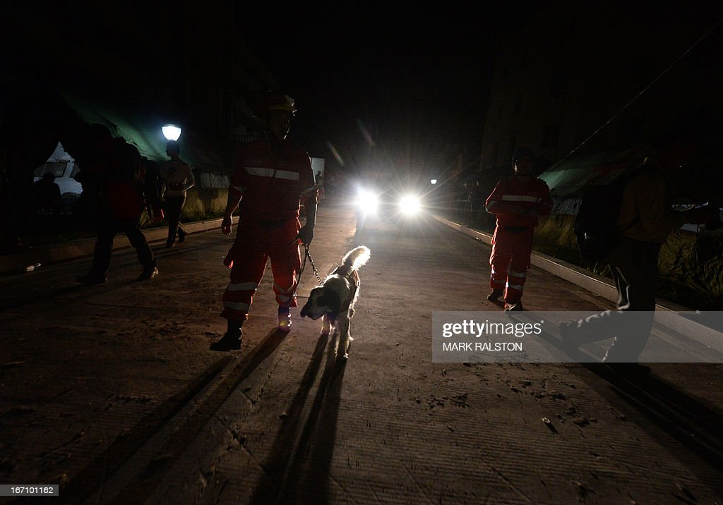 A rescue worker walks with a sniffer dog after a magnitude 7.0 earthquake hit the city of Ya'an, in southwest China's Sichuan province on April 20, 2013. More than 150 people were killed and 5,700 injured when a strong earthquake hit a mountainous part of southwestern China on April 20, destroying thousands of homes and triggering landslides in an area devastated by a major tremor in 2008.