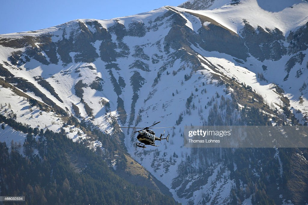 Rescue workers and gendarmerie continue their search operation near the site of the Germanwings plane crash on March 29 2015 in Seyne les Alpes...