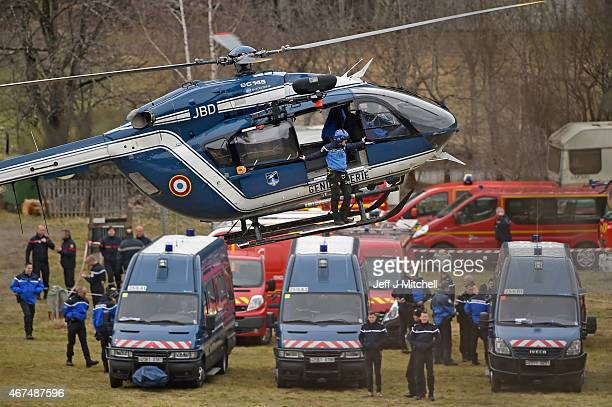 Rescue workers and gendarmerie via helicopter continue their search operation near the site of the Germanwings plane crash near the French Alps on...