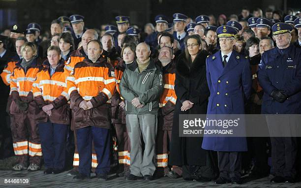 Rescue workers and police attend a commemoration for victims of knife attack at a Belgian creche on January 26 in which accused Kim Van Gelder barged...