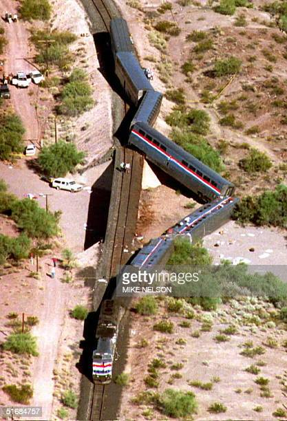 Rescue workers and vehicles assist at the site of the Amtrak Sunset Limited train after it derailed 60 miles southwest of Phoenix 09 October The...