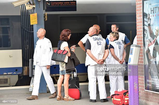 Rescue workers are seen on a platform at the main train station in Arras northern France on August 21 2015 A gunman opened fire on a train travelling...