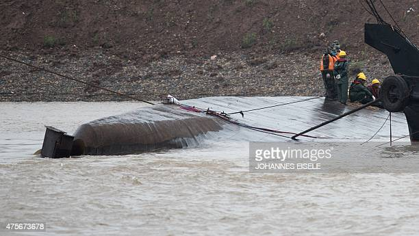 Rescue workers are seen on the hull of capsized passenger ship Dongfangzhixing or 'Eastern Star' in the Yangtze river at Jianli in China's Hubei...