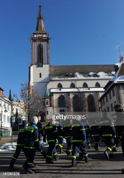 Rescue workers arrive on December 1 2012 at the Sankt Jakobus church in TitiseeNeustadt southern Germany for an oecumenical service for the victims...