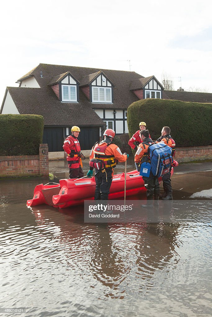Rescue workers attend at the village of Wraysbury on the banks of the river Thames on February 13, 2014 in Wraysbury, England. The Environment Agency continues to issue severe flood warnings for a number of areas on the River Thames in the commuter belt west of London. With heavier rains forecast, people are preparing for the water levels to rise.
