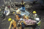 Rescue workers carry a corpse after a landslide in Salgar Municipality Antioquia department Colombia on May 19 2015 A massive landslide tore through...