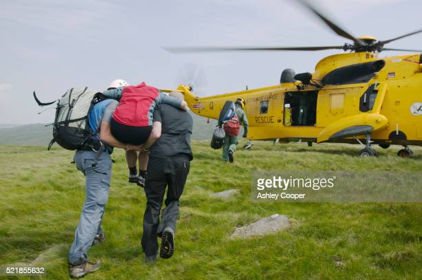 Rescue Workers Carrying Victim
