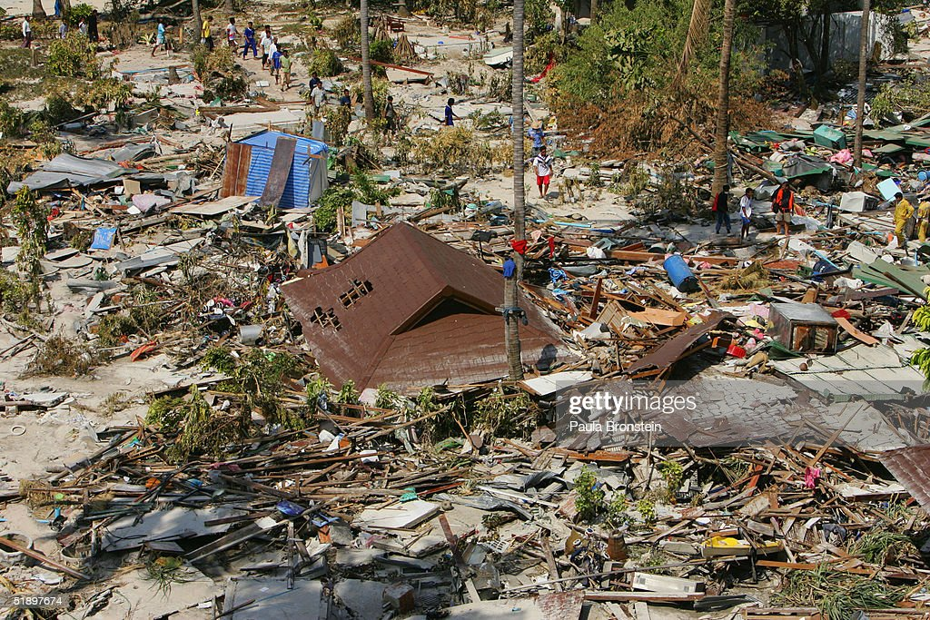 Rescue workers comb through the devastation December 28 2004 in Phi Phi Village Ton Sai Bay Thailand Hundreds were killed on the island when an...