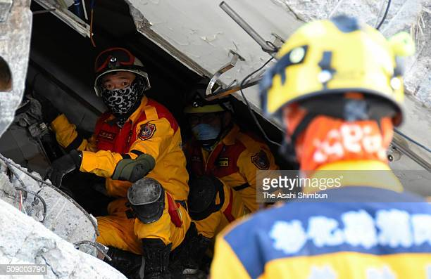 Rescue workers continue the searching operation of the missing at a collapsed building after the magnitude 64 earthquake jolted on Saturday on...