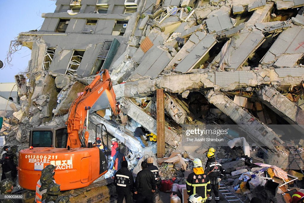 Rescue workers continue the searching operation of the missing at a collapsed building after the magnitude 6.4 earthquake jolted on Saturday on February 8, 2016 in Tainan, Taiwan. As the crucial 72-hour approaching, more than 100 people are believed to be trapped in the building.