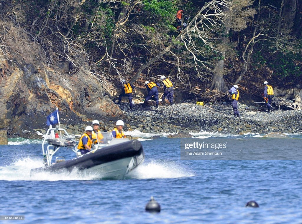 Rescue workers formed by Miyagi Prefecture Police and Japan Coast Guard continue searching the missings on September 11, 2012 in Minamisanriku, Miyagi, Japan. 18 months on, still 2,814 people are missing and 340,000 people are forced to live at temporary housing.