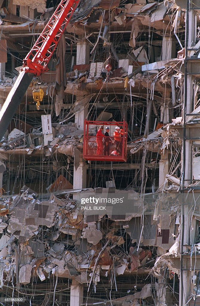 Rescue workers (C) in a basket survey damages 20 April 1995 to the Albert P. Murrah Federal Building in Oklahoma City, one day after a fuel-and-fertilizer truck bomb exploded in front of the building. The blast, the worst terror attack on US soil, killed 168 people and injured more than 500. Timothy McVeigh, convicted on first-degree murder charges for the 19 April bombing was sentenced to death in 1997.