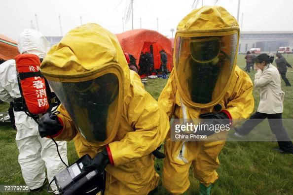 Rescue workers in protective suits detect air pollution in a simulated chlorine leakage during the public emergency drill held at Changchun...