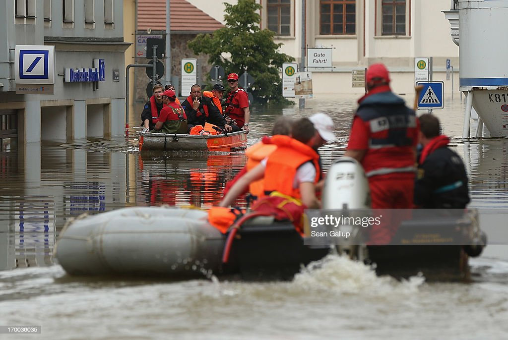 Rescue workers in rubber boats pass through streets flooded by the nearby Elbe river in the historic city center on June 6, 2013 in Meissen, Germany. Eastern and southern Germany are suffering under floods that in some cases are the worst in 400 years. At least four people are dead and tens of thousands have evacuated their homes.