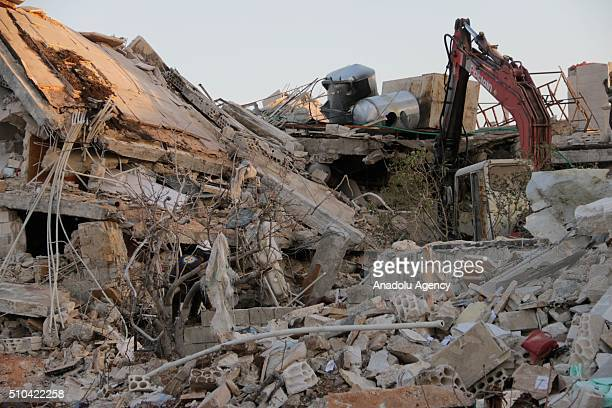 Rescue workers inspect the debris of a collapsed hospital belongs to humanitarian aid organization 'Doctors Without Borders' to save victims after...