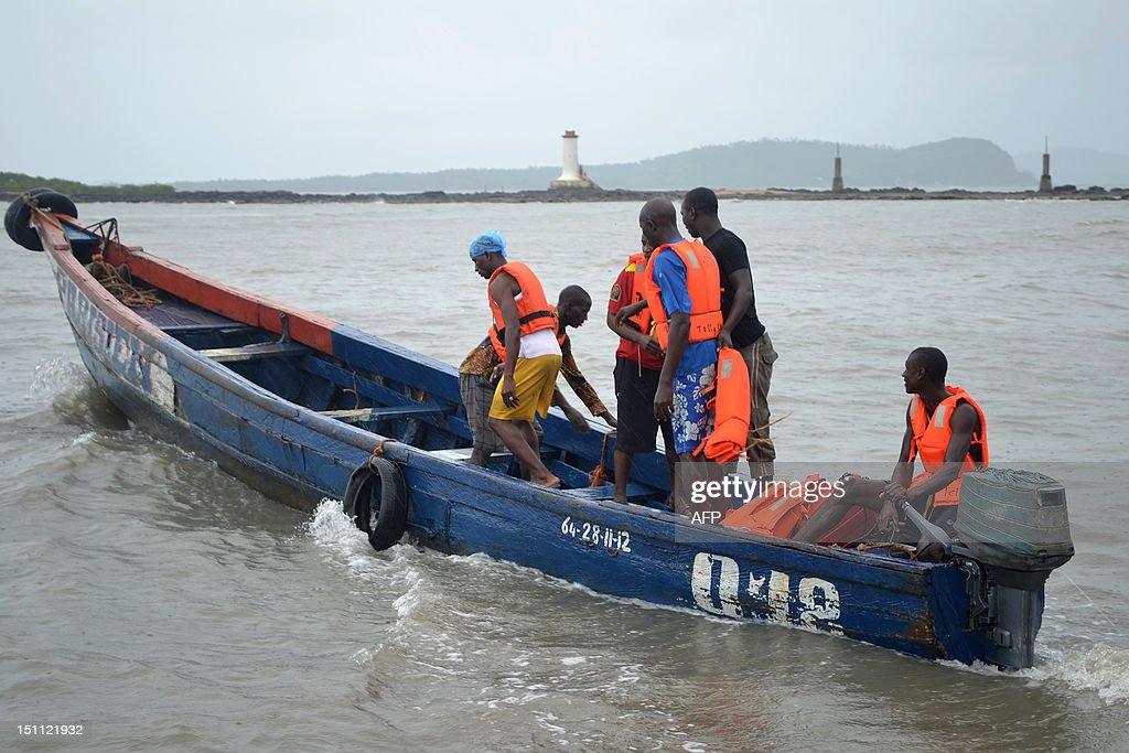 Rescue workers leave the coast to find the victims of a capsized pirogue on September 1, 2012 in Conakry. About 30 people were believed to have drowned after an overloaded boat sank off the coast of Guinea, as rescue workers said Saturday they had given up hope of finding survivors after an all-night search. The pirogue, a flat-bottomed boat used by fishermen and for transport, capsized a few minutes after setting off for Kassa Island which lies several kilometres (miles) from the capital Conakry on August 31.