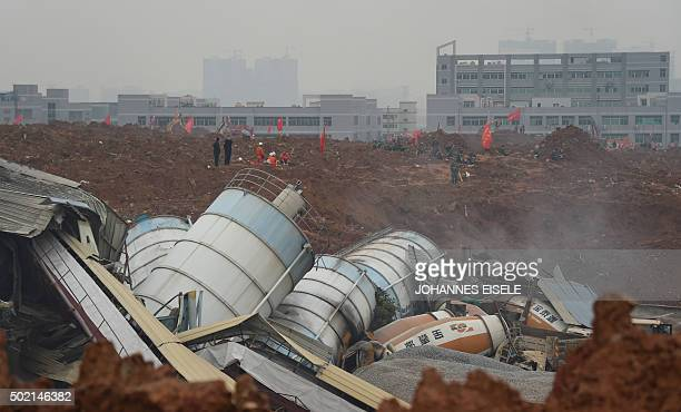 Rescue workers look for survivors after a landslide hit an industrial park in Shenzhen south China's Guangdong province on December 21 2015 A...