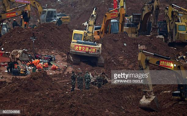 Rescue workers look for survivors after a landslide hit an industrial park in Shenzhen south China's Guangdong province on December 22 2015 Rescuers...