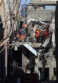 Rescue workers look for survivors at a factory in the Davutpasa district of Istanbul Turkey on Thursday Jan 31 2008 An explosion at an unlicensed...
