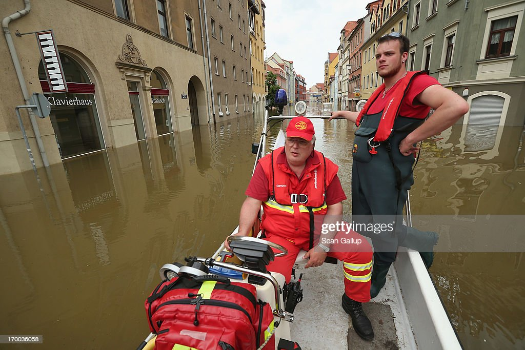 Rescue workers of the Deutsche Lebens- und Rettungs Gesellschaft (DLRG, or German Life Saving Association) ride in rubber boat through streets flooded by the nearby Elbe river in the historic city center on June 6, 2013 in Meissen, Germany. Eastern and southern Germany are suffering under floods that in some cases are the worst in 400 years. At least four people are dead and tens of thousands have evacuated their homes.