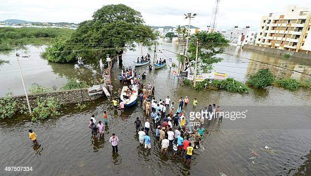Rescue workers on a boat move people to safety at a residential area in rainhit areas on the outskirts of Chennai on November 17 2015 India has...