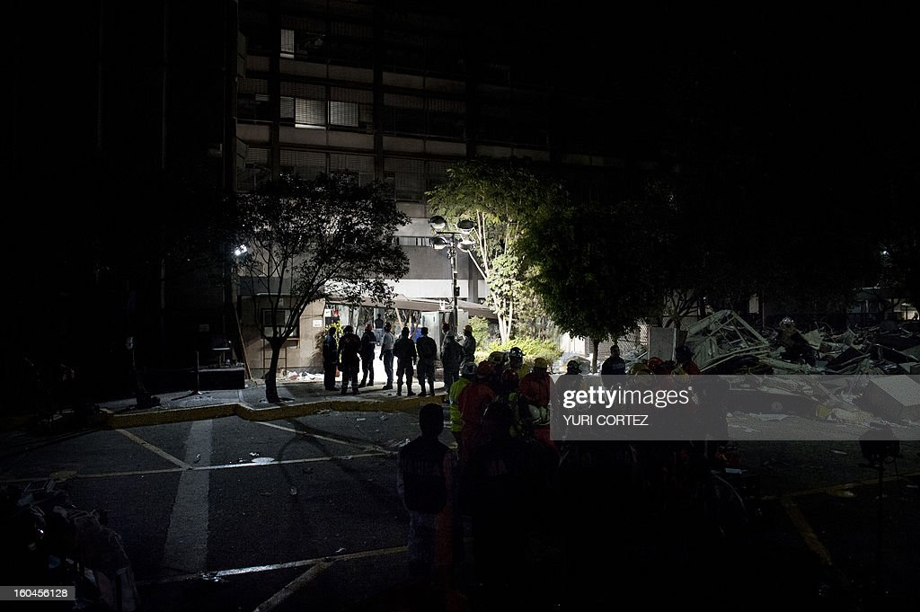 Rescue workers prepare to search for victims at the headquarters of state-owned Mexican oil giant Pemex in Mexico City on January 31, 2013, following a blast inside the building. An explosion rocked the skyscraper, leaving up to 25 dead and 101 injured, as a plume of black smoke billowed from the 54-floor tower, according to official sources.