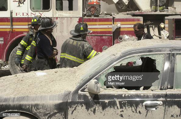 Rescue workers provide aid to people after the collapse of the World Trade Center on Sept 11 2001