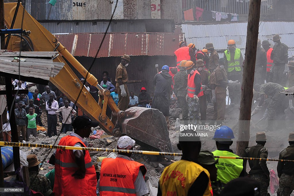 Rescue workers remove debris from the rubble of the six-storey building that collapsed killing 23 people in Nairobi's suburb of Huruma, on May 3, 2016. Kenyan rescuers pulled an 18-month-old toddler alive from the rubble of a six-storey building on May 3, four days after the block collapsed killing 23 people, police said. Located in the poor, tightly-packed Huruma neighbourhood, the building had been slated for demolition after being declared structurally unsound. But an evacuation order for the structure, which was built near a river just two years ago, was ignored. MAINA