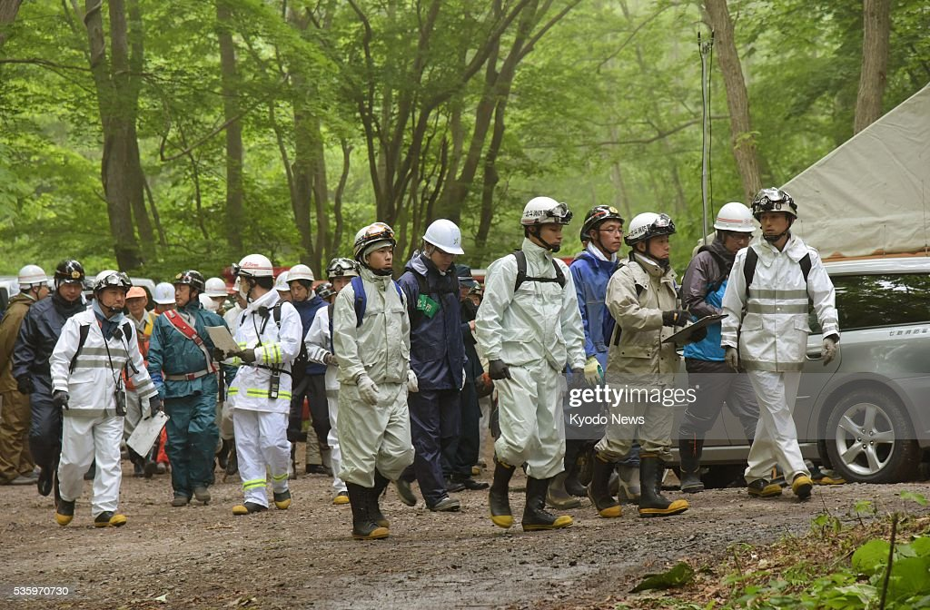 Rescue workers restart searching for a 7-year-old boy in mountain forest in Japan's northernmost prefecture of Hokkaido on May 31, 2016, after he went missing on May 28 after being left behind by his parents as punishment for misbehaving.