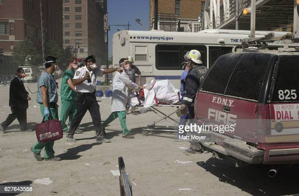 Rescue workers rush to help those injured by the attack on The World Trade Center on Sept 11 2001