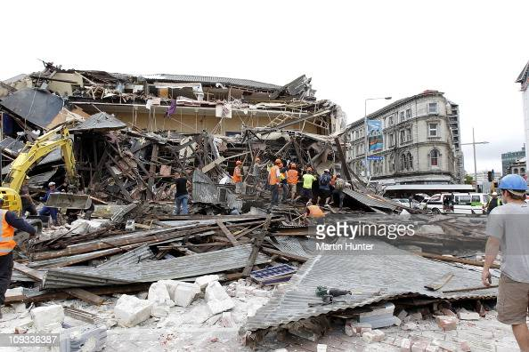 Rescue workers search for survivors through debris on February 22 2011 in Christchurch New Zealand The 63 magnitude earthquake an aftershock of the...