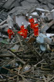 Rescue workers search for victims in the debris of a building May 14 2008 in Beichuan Town of Mianyang City of Sichuan Province China A major...