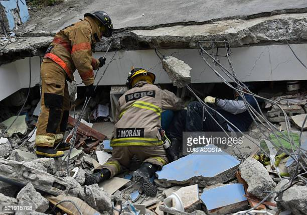 TOPSHOT Rescue workers search the rubble after a 78magnitude quake in Gauyaquil Ecuador on April 17 2016 At least 235 people were killed when a...
