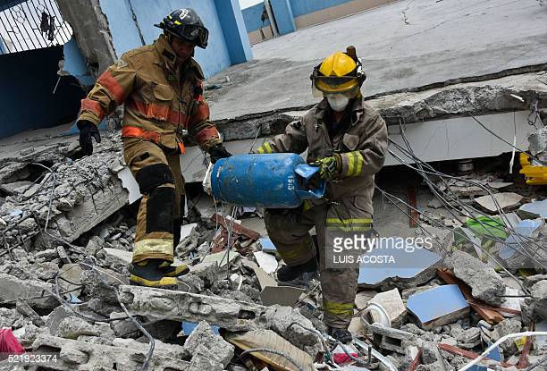 Rescue workers search the rubble after a 78magnitude quake in Gauyaquil Ecuador on April 17 2016 At least 235 people were killed when a powerful...