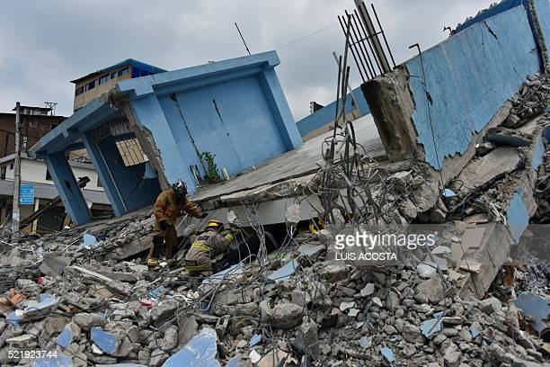 TOPSHOT Rescue workers search the rubble after a 78magnitude quake in Guayaquil Ecuador on April 17 2016 At least 235 people were killed when a...