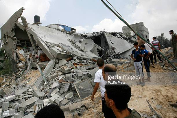 Rescue workers search the rubble of Palestinian homes after an Israeli air strike on Khan Yunis in the southern Gaza strip The death toll in Gaza...