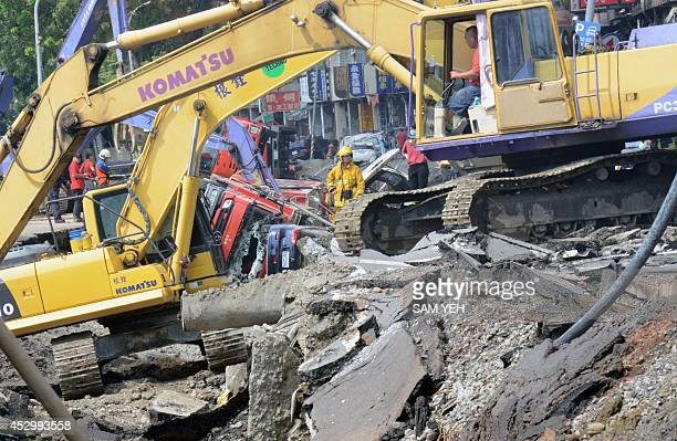 Rescue workers search through the gas explosion site in the southern Taiwan city of Kaohsiung on August 1 2014 A series of powerful gas blasts killed...