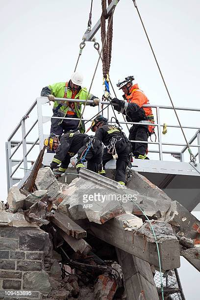 Rescue workers stabilise the tower of the Christchurch cathedral in Christchurch on February 25 2011 Rescuers have ruled out finding survivors at...