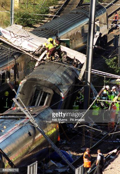 Rescue workers surround the wreckage of the train crash in west London where a number of passengers have died and over a hundred more were injured...