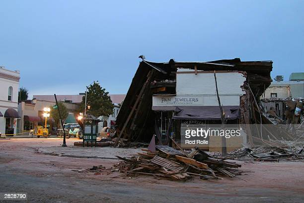 Rescue workers survey damage while searching for survivors December 22 2003 in Paso Robles California The 65 richter scale earthquake hit the central...