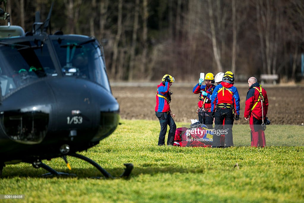 Rescue workers tend to an injured persom after two trains collided head-on in Bavaria on February 9, 2016 near Bad Aibling, Germany. Authorities say at least nine people are dead and over 100 injured in the collision between two trains of the Meridian local commuter train service that occurred at approximately 7 am.